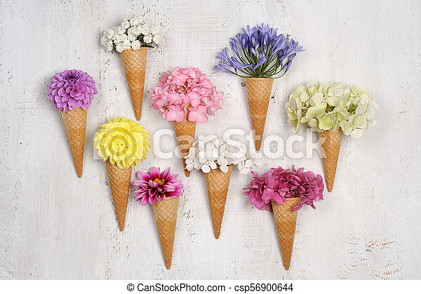 ice cream cones with beautiful flowers - csp56900644