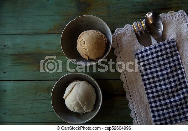 ice cream on wood background - csp52604996