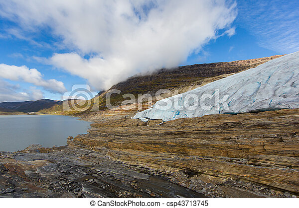 Ice front of Svartisen Glacier in Norway with lake - csp43713745