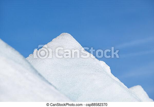 Ice pyramids on blue sky background. - csp88582370