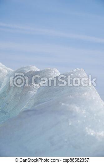 Ice pyramids on blue sky background. - csp88582357
