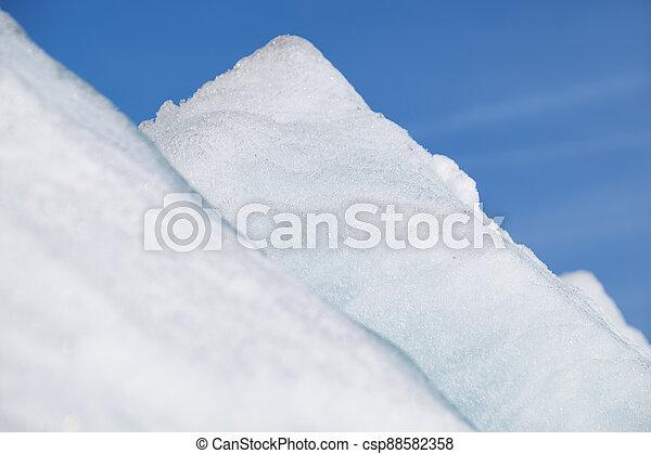 Ice pyramids on blue sky background. - csp88582358