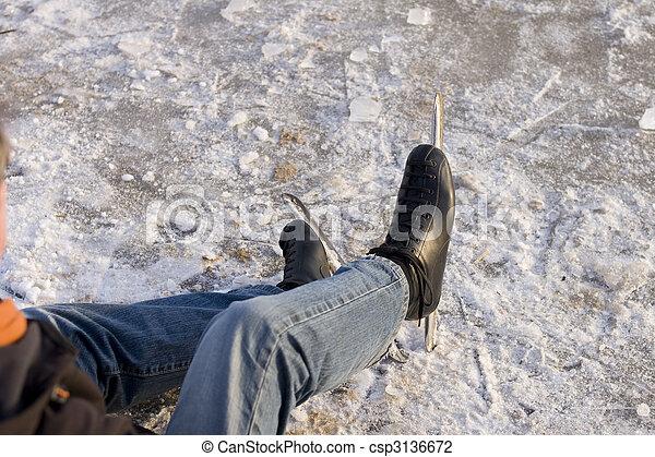 Ice skater sitting on ice - csp3136672