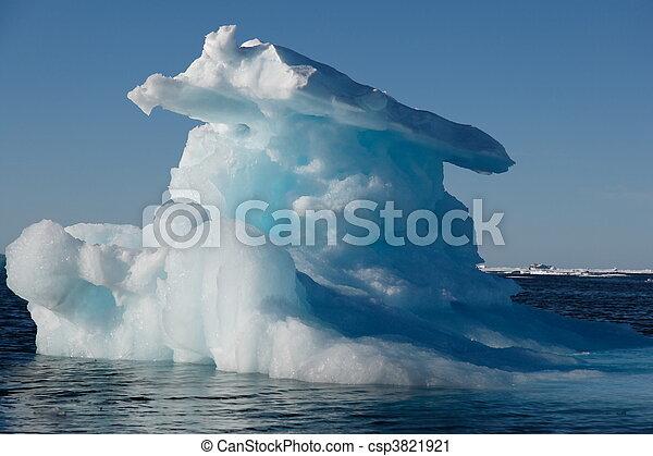 Iceberg in Nunavut with sunshine (canadian arctic sea) - csp3821921