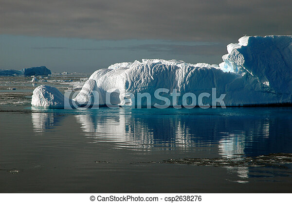 Iceberg in sunlight with water reflection - csp2638276