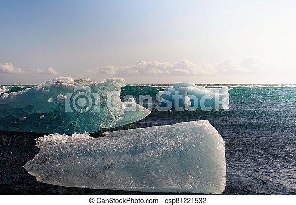 Icebergs lying on the Diamond Beach in Jokulsarlon Glacier Lagoon, Iceland - csp81221532