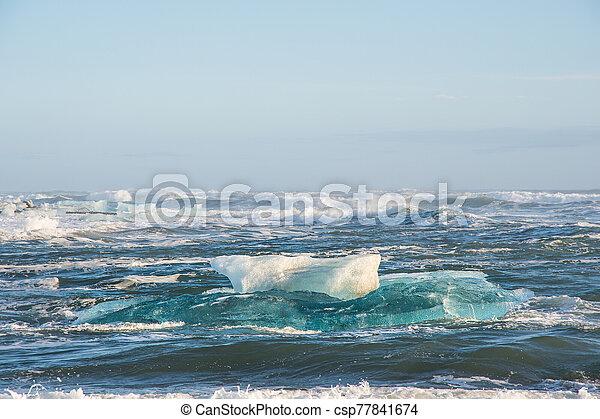 Icebergs on the coast of Diamond beach near Jokulsarlon in South Iceland - csp77841674