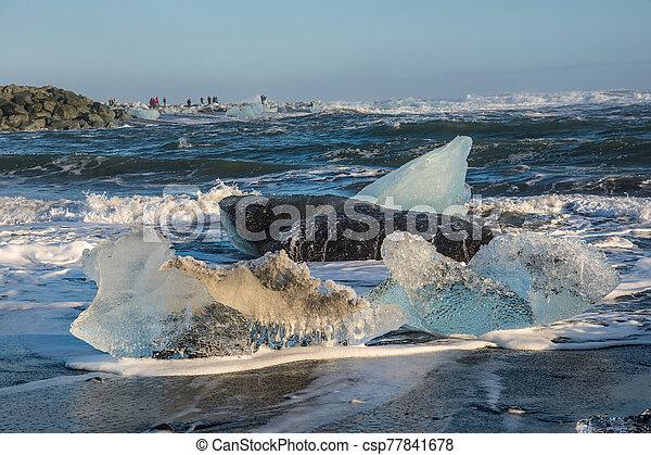 Icebergs on the coast of Diamond beach near Jokulsarlon in South Iceland - csp77841678