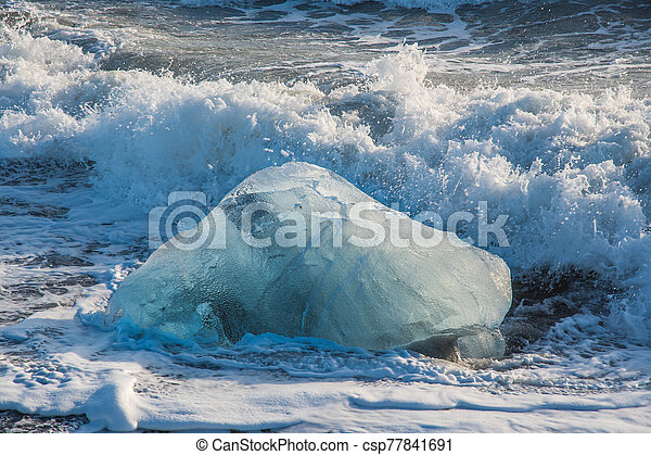 Icebergs on the coast of Diamond beach near Jokulsarlon in South Iceland - csp77841691