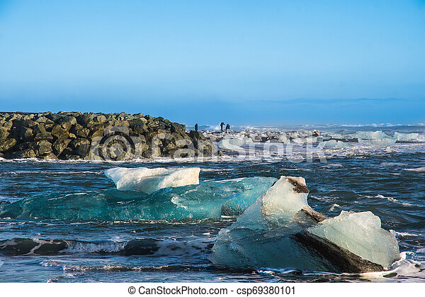 Icebergs on the coast of Diamond beach near Jokulsarlon in South Iceland - csp69380101