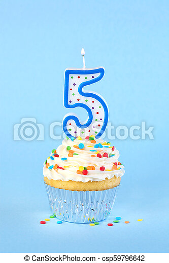 Iced birthday cupcake with with lit number 5 candle and sprinkles - csp59796642