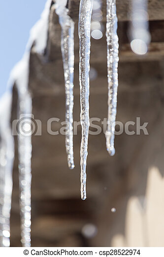 Icicles hanging from roof - csp28522974