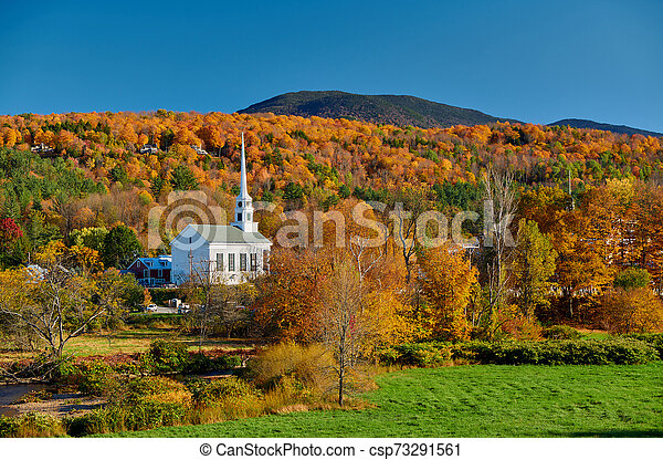 Iconic New England church in Stowe town at autumn - csp73291561