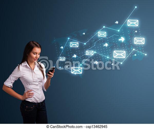 Jovencita sosteniendo un teléfono con flechas y símbolos de mensaje - csp13462945