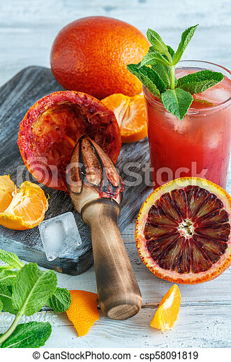 Icy juice from the blood orange and citrus press. - csp58091819