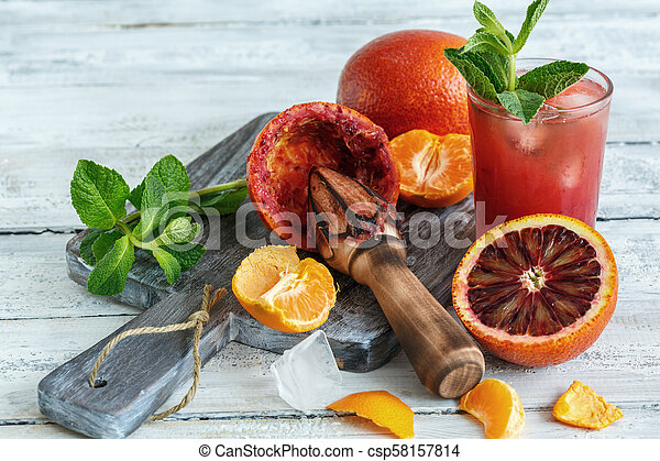 Icy juice from the blood orange and citrus press. - csp58157814