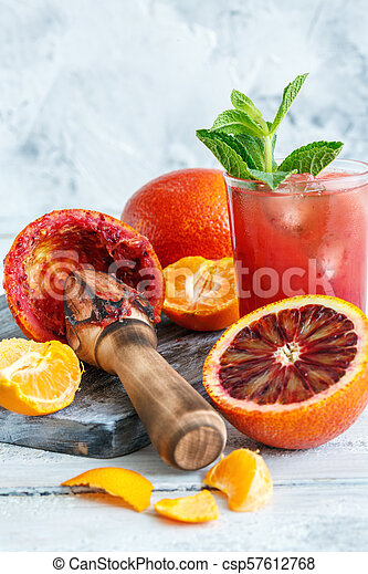 Icy juice from the blood orange and citrus press. - csp57612768
