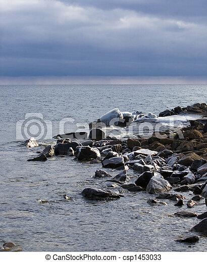 Icy Shore with Rain on the Horizon - csp1453033