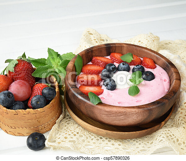 Ideas for healthy summer breakfast op dessert. Smoothies in bowls with strawberry, blueberry berry. With oatmeal, fresh berries. - csp57890326