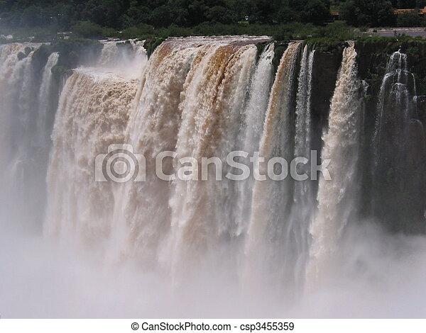Iguassu waterfalls on a sunny day early in the morning. The biggest waterfalls on earth. - csp3455359