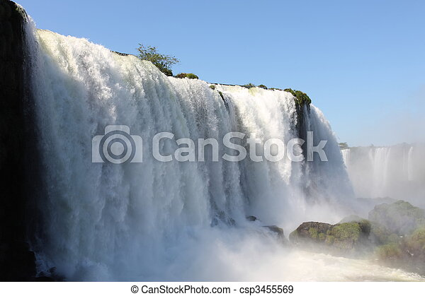 Iguassu waterfalls on a sunny day early in the morning. The biggest waterfalls on earth. - csp3455569