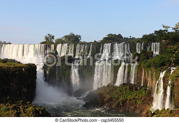 Iguassu waterfalls on a sunny day early in the morning. The biggest waterfalls on earth. - csp3455550