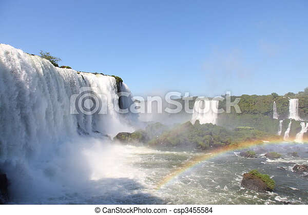 Iguassu waterfalls with rainbow on a sunny day early in the morning. The biggest waterfalls on earth. - csp3455584