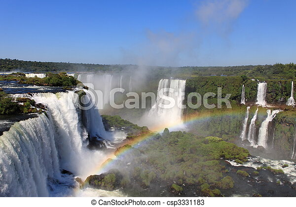 Iguazu waterfalls with rainbow on a sunny day. The largest waterfall on earth - csp3331183