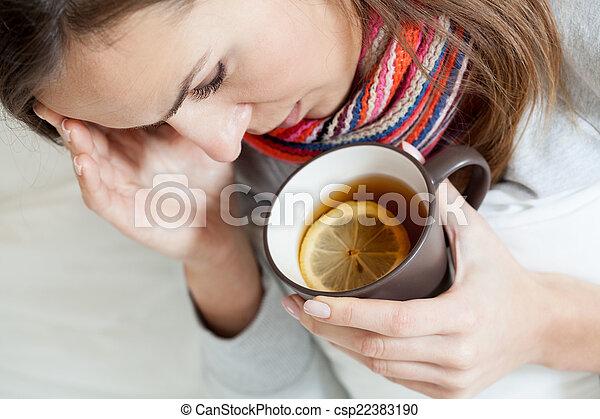 Ill woman drinking tea - csp22383190