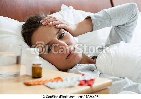 Ill woman feeling headache - csp24224436