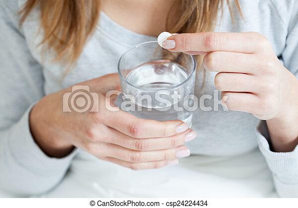 Ill woman taking aspirin - csp24224434