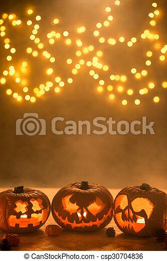Illuminated carved halloween pumpkins lanterns - csp30704836