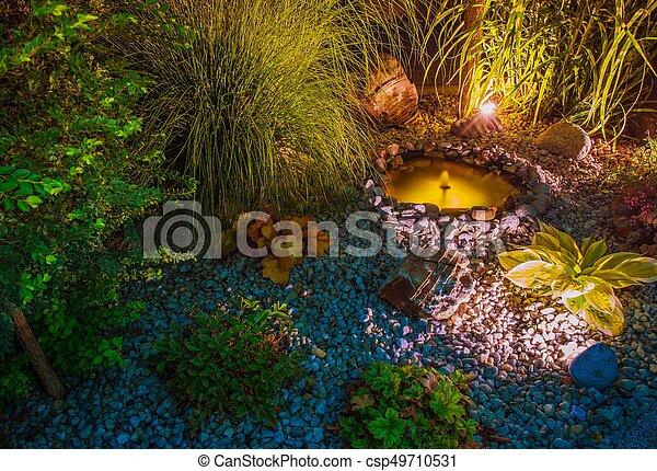 Illuminated Garden with Pond - csp49710531