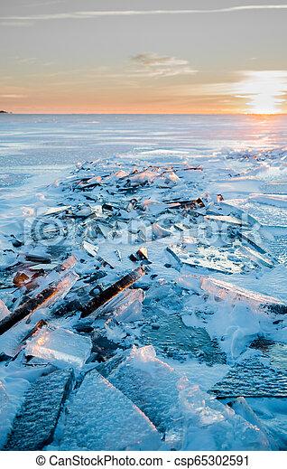 Illuminated Winter Sunset Over Lake Ontario - csp65302591