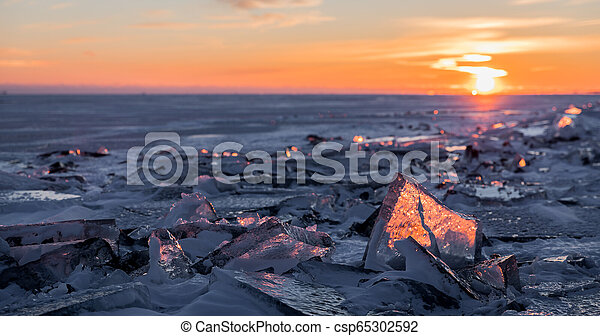 Illuminated Winter Sunset Over Lake Ontario - csp65302592