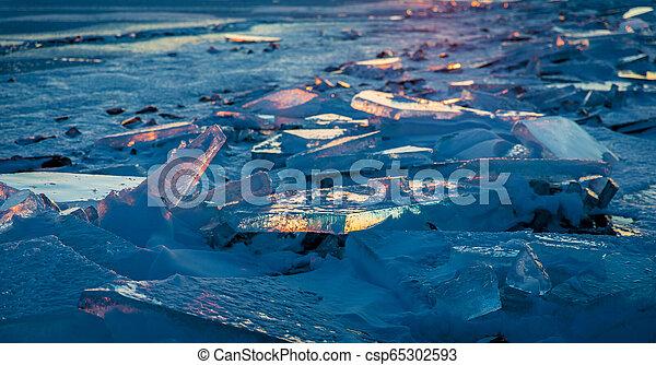 Illuminated Winter Sunset Over Lake Ontario - csp65302593