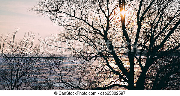 Illuminated Winter Sunset Over Lake Ontario - csp65302597
