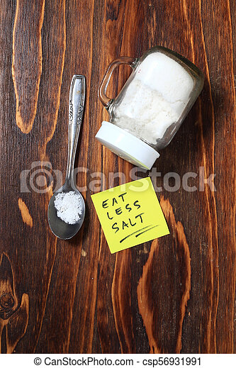 illustration for healthy life style, spilled salt at wooden board - csp56931991