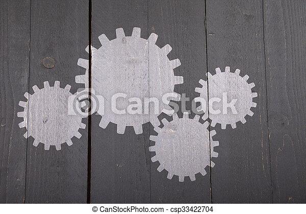 Illustration of white gears on dark black wooden background - csp33422704