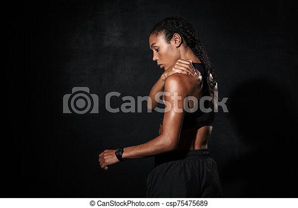 Image from back of feminine african american woman in sportswear - csp75475689