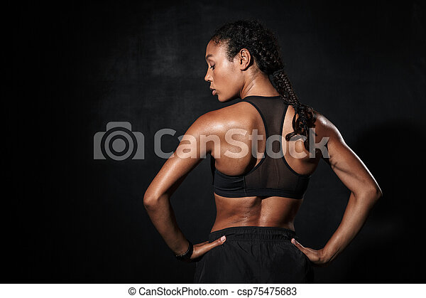 Image from back of slim african american woman in sportswear - csp75475683