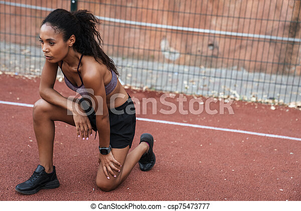 Image of african american woman sitting at playground outdoors - csp75473777