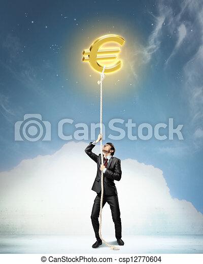 Image of businessman climbing rope - csp12770604