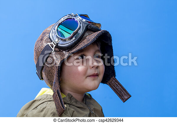 imagination fun and funny child dressed in aviator hat and goggles
