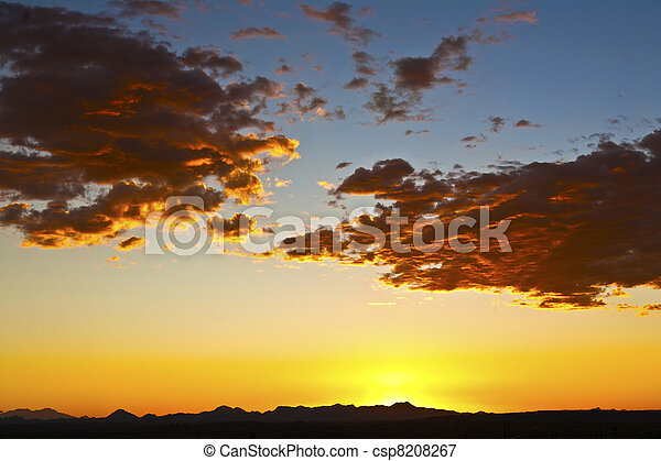 impressive sunset in the desert in Arizona with golden clouds - csp8208267