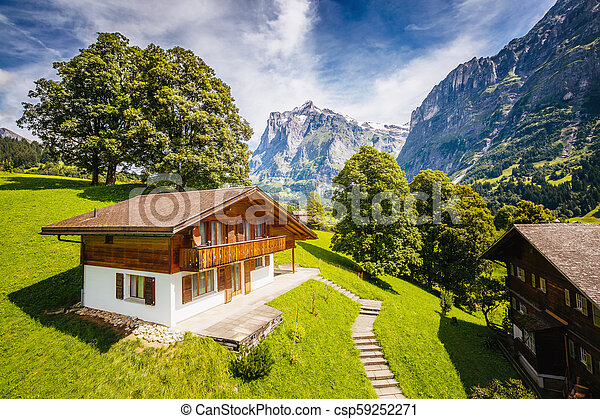 Impressive view of alpine Eiger village. Location place Swiss alps, Grindelwald valley, Europe. - csp59252271
