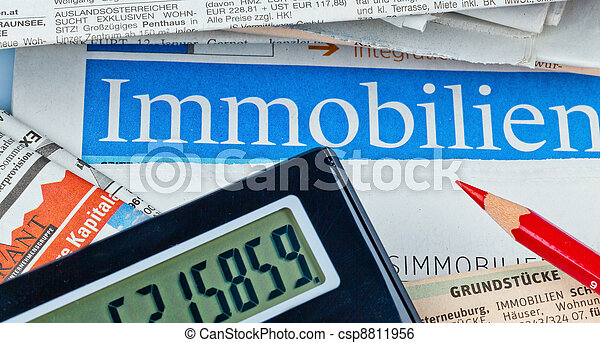 in a newspaper properties are offered for sale. ads for home purchase and housing. - csp8811956