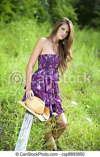 in field sitting on a rail - csp8893850