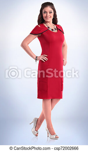 in full growth. stylish young woman in red dress. - csp72002666