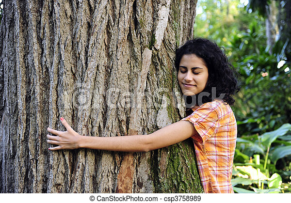 In love with nature: woman hugging a tree in the forest - csp3758989